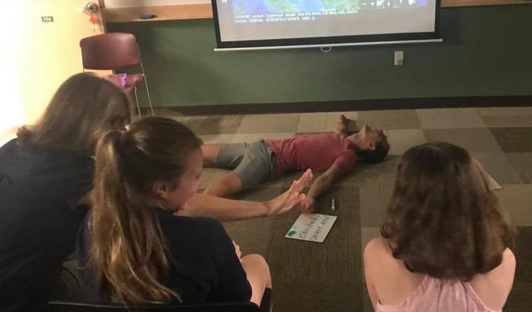 JSB rolling on the floor laughing after student comment at Express Fluency 2018