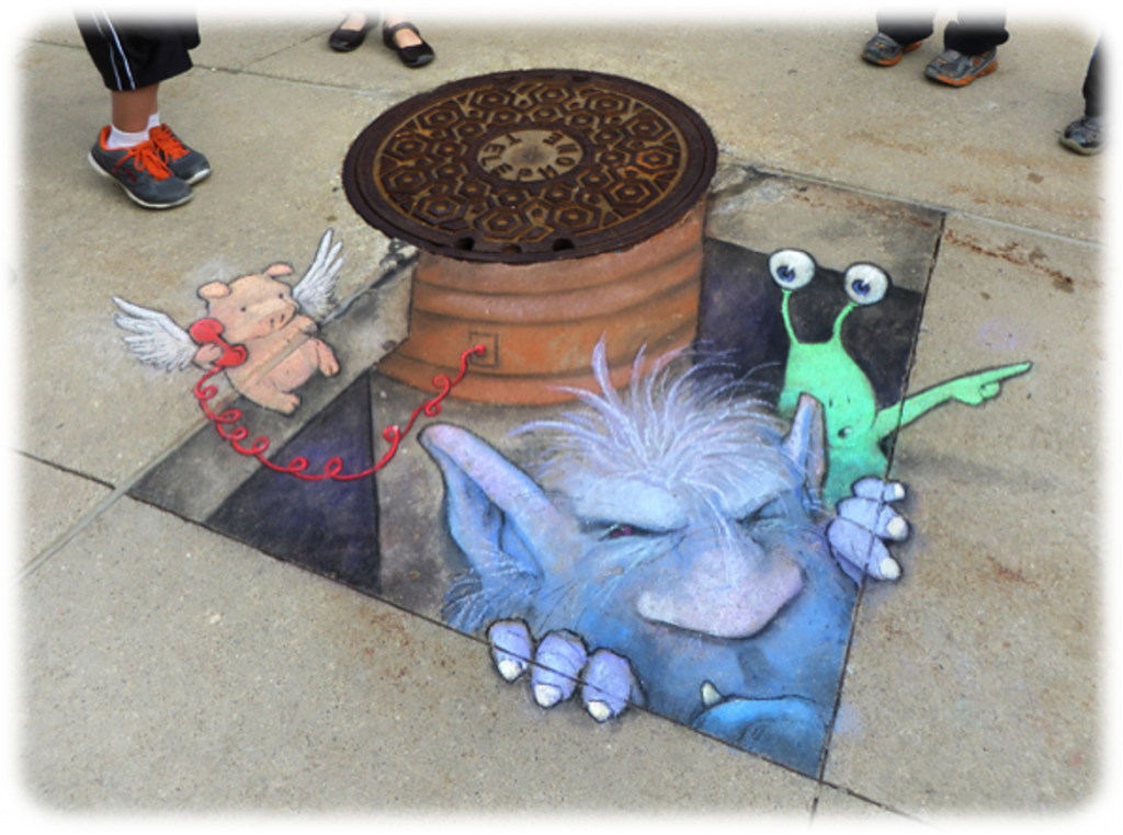 Chalk drawing on sidewalk of cute monsters emerging from underground